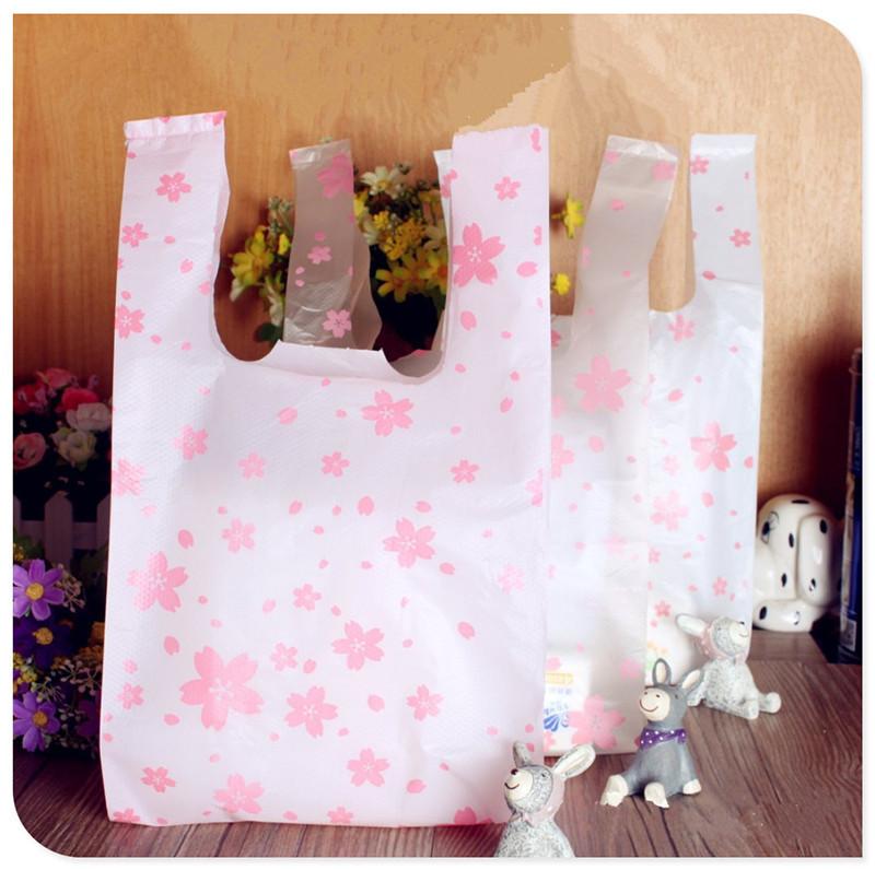"Free shipping size 18*35cm(7""*14"") Supermarket Shopping plastic Bag with handle printing Cherry blossom plastic bag 100pcs/lot(China (Mainland))"