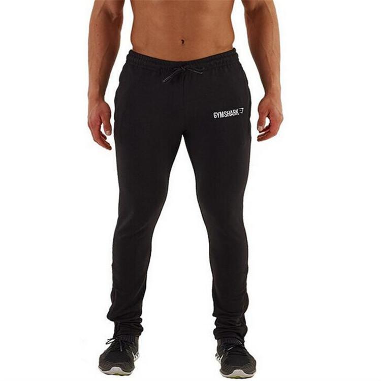 2017 Muscle men's bodybuilding pants men runs fitness pants gyms man trousers black xxl slim sporting man pants soft sweatpants(China (Mainland))