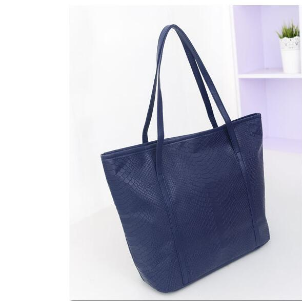 Simple large capacity handbags, fashionable shopping bags, outdoor leisure Messenger bag free shipping factory direct sales(China (Mainland))