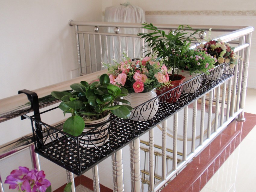Special wrought iron balconies hanging flower pots - Flower pots to hang on fence ...