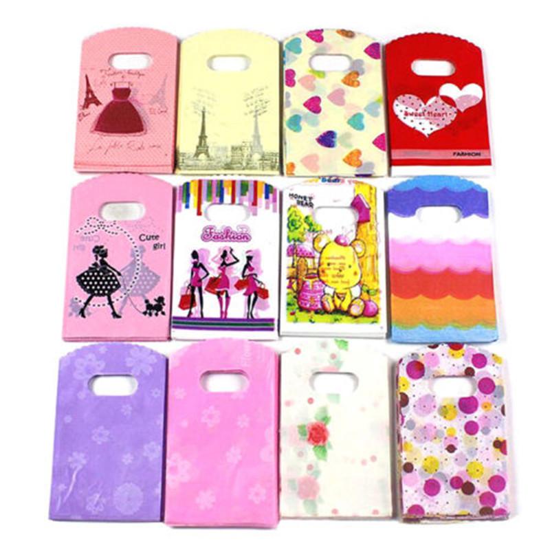 50pcs Wholesale Lot Pretty Mixed Pattern Plastic Gift Bag Shopping Bag 15X9CM(China (Mainland))