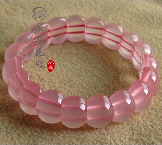 Natural ice kinds of powder pink crystal hand row women's pink crystal bracelet dr. peach(China (Mainland))