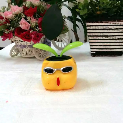 Free Shipping 2 Pieces Per Lot Leaves Swing No Battery No Water Flip Flap Novelty Cartoon Toy Happy Dancing Solar Flower(China (Mainland))