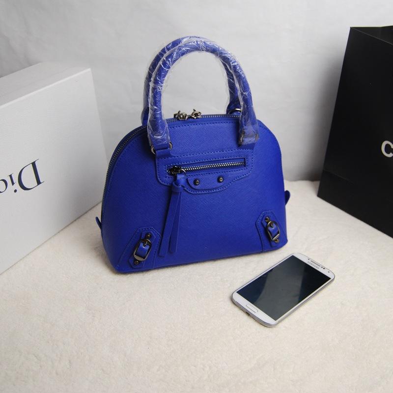 2015 New Head Cross grain cowhide shell bag rivets tassel leather handbag portable shoulder diagonal packet mini, free shipping(China (Mainland))