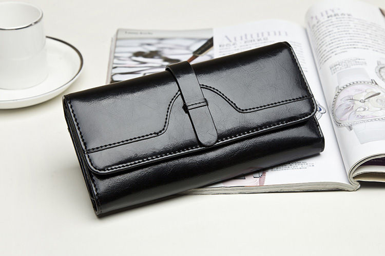 2015The new oil wax cowhide wallet lady seventy percent off foreign high-grade long section of Leather Fashion Ladies Wallet(China (Mainland))