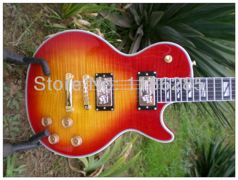 Free shipping Chinese musical instrument earth logo cherry sunburst fret binding les gbson paul lp supreme electric guitar(China (Mainland))
