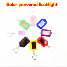 Mini Solar toys Flashlight Key Chain White light Fashion Solar Power Charging toys keychain Camping Supplies(China (Mainland))