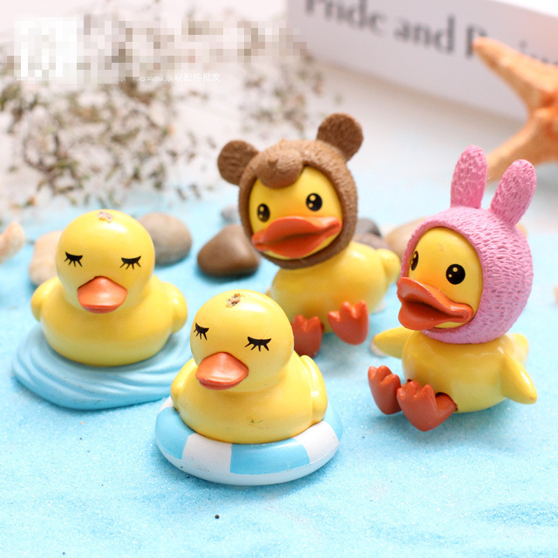 4Pcs Lot anime Model Toy Yellow Duck Mini Toy DIY Figurines For Decor Children Toys Model A Birthday Present Height 4.5 CM(China (Mainland))