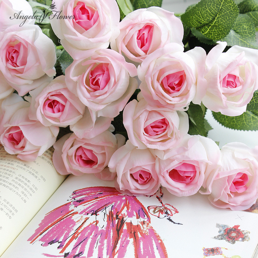 Buy comely moist real touching rose for Angela florist decoration