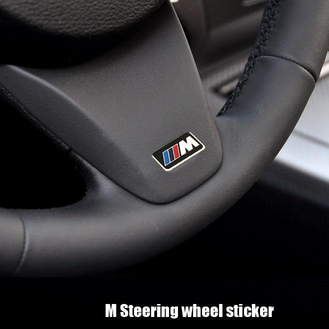 2pcs Stainless steel M Car wheel steering sticker for BMW E90 E91 E92 E93 F30 F20 F10 F15 F13 M3 M5 M6(China (Mainland))