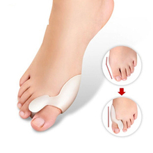 2pcs=1pair Silicone Foot Massager Toe Separator Fingers Thumb Valgus Protector Bunion Adjuster Hallux Valgus Guard Feet Care(China (Mainland))