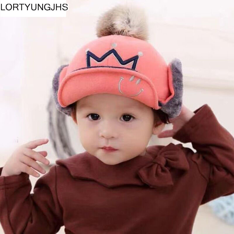 Autumn new male andboys and g children's rabbit fur ball warm ear caps infants Mao Rongdong section along the Lei Feng hat(China (Mainland))
