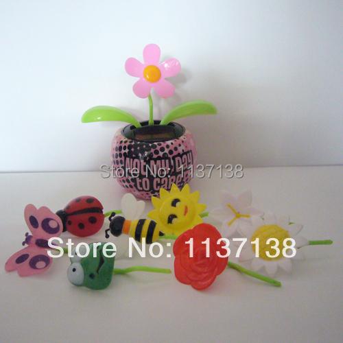 Wholesale 10 Pieces Per Lot Swing No Batterty No Water Happy Dancing Car Decoration Flip Flap Solar Novelty Toys(China (Mainland))