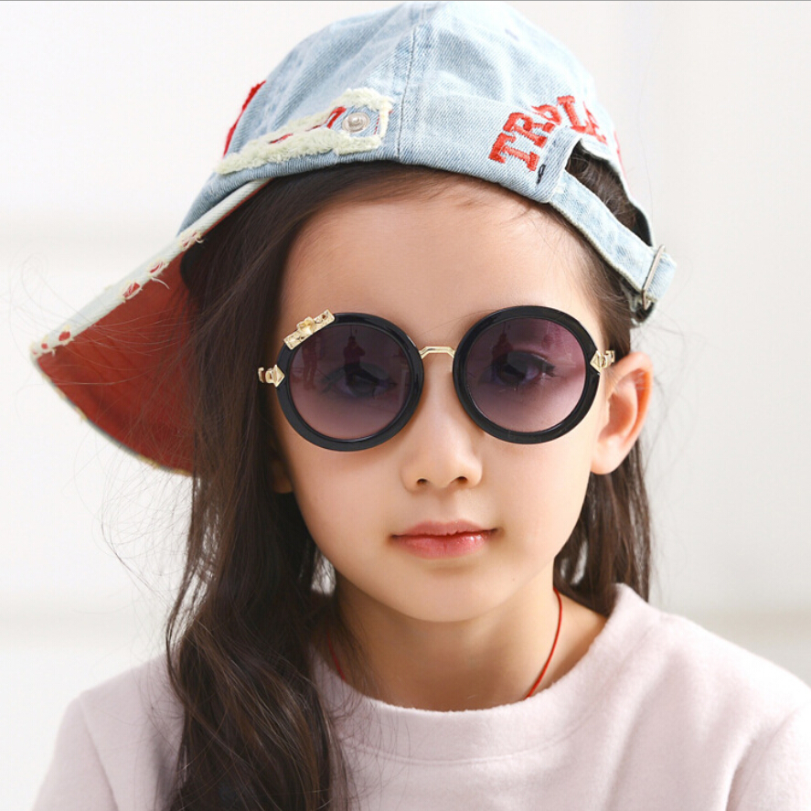 High Quality Fashion Bowknot 100% UV400 Small Round Photochromic Lens Kids Sunglasses For Girls Boys Rimless Pink Red Frame