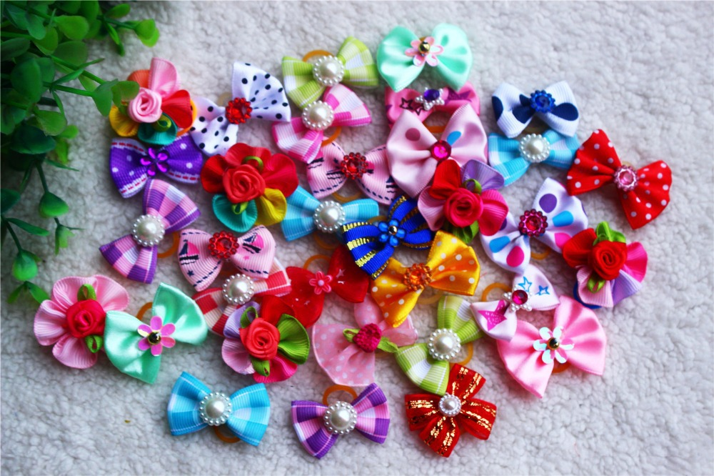 Hot Sales 100pcs Cute Rhinestone Pearls Flowers dog bows pet dog hair bows dog hair accessories Pet grooming products Cute Gift