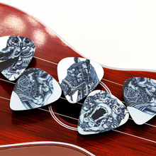 10PCS 0.71mm high quality guitar picks two side pick Black and white animal picks earrings DIY Mix picks guitar(China (Mainland))