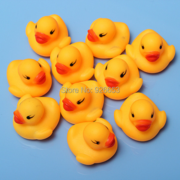 Free Shipping 10Pcs/Bag Baby Kid Cute Bath Rubber Ducks Children Squeaky Ducky Water Play Toy(China (Mainland))