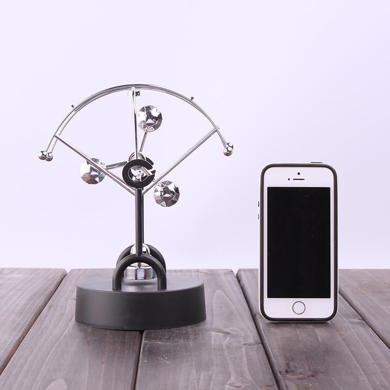electric perpetual wiggler ornament,Newton pendulum ball office decoration creative business Christmas gift(China (Mainland))