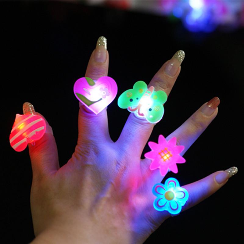 Glowing cartoon finger rings LED flashing light toy for kids birthday party favors,animal fruit design ring 1200pcs/lot(China (Mainland))