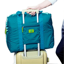 2015 Foldable brand designer luggage travels bags organizer waterproof dry women and men duffle carry on luggage traveling bag
