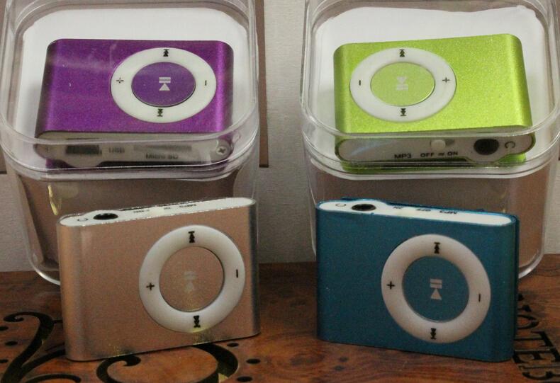 Dazzle colour square fluorescent MP3 mini card MP3 portable portable Small lingling(China (Mainland))