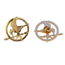 Buy 2014 new Golden hunger games laugh bird brooch Women's Collar Brooches for $19.33 in AliExpress store