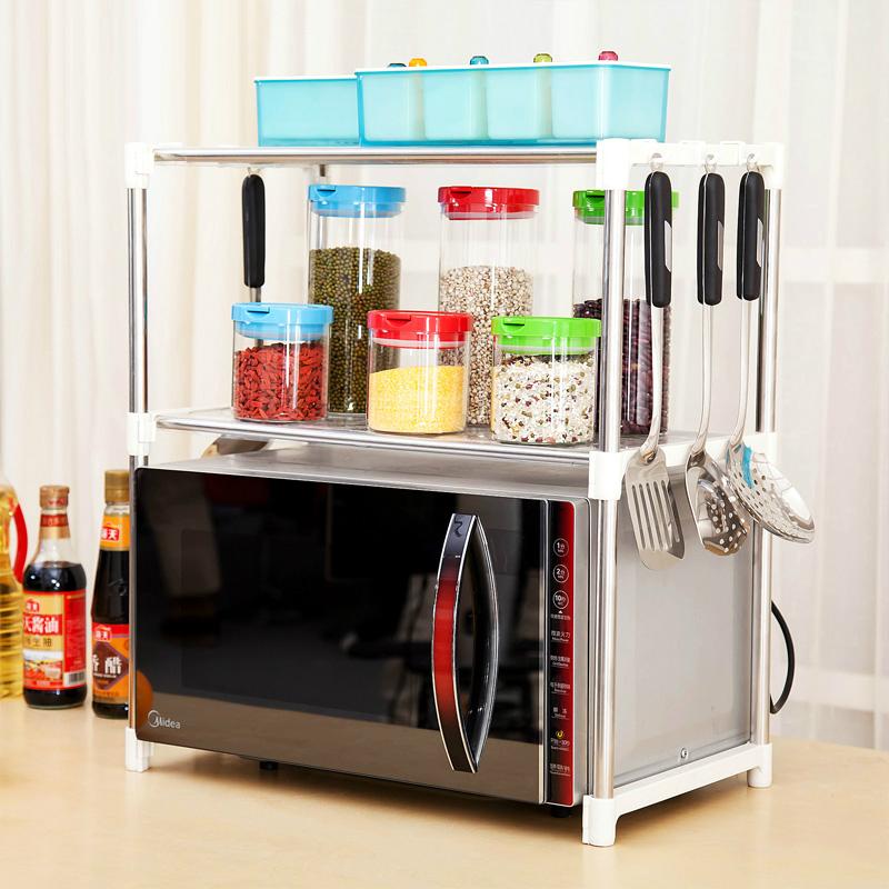 Microwave oven shelf 2 201 stainless steel adjustable altitudinal belt plastic shelf shelving(China (Mainland))