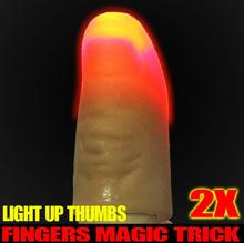 2 Pcs Light Up Thumbs Fingers Magic Trick Thumbs Tips Evening Night Toy(China (Mainland))