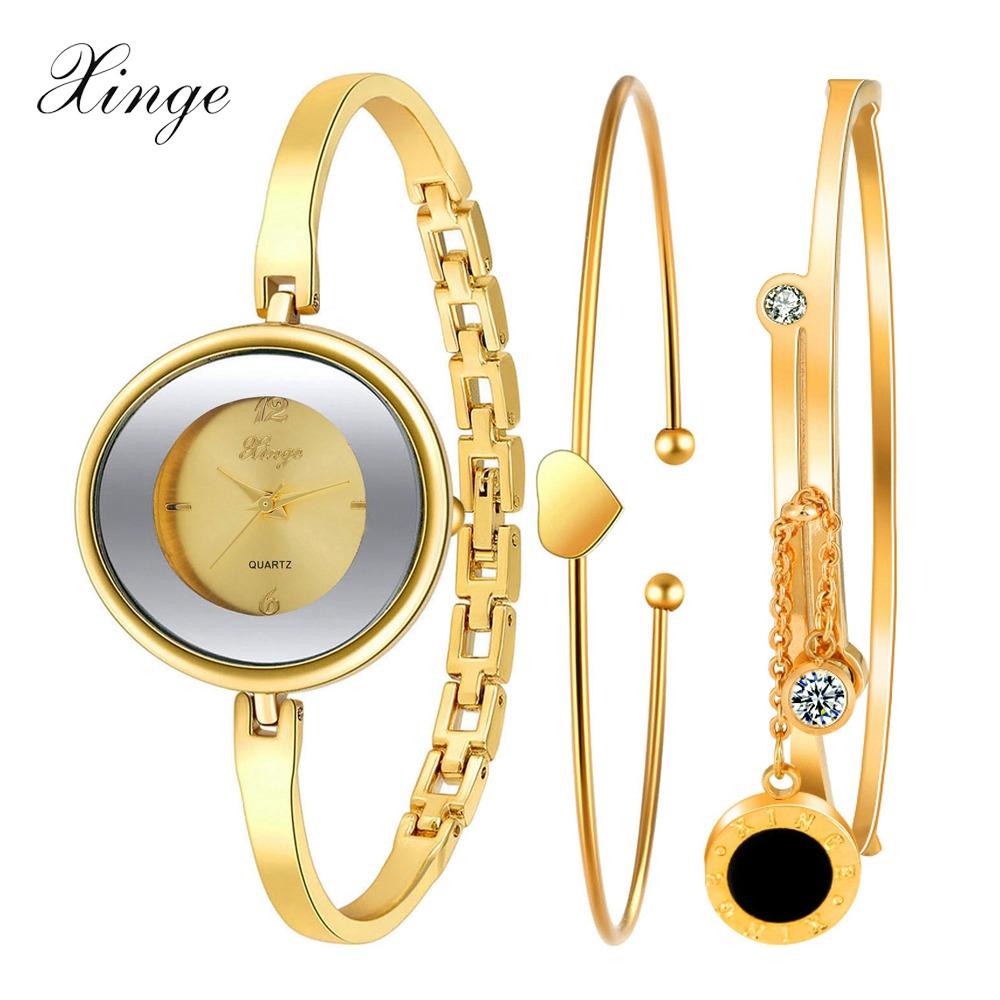 Xinge Brand Watch Women Gold Pendant Luxury Stainless Steel Bracelet Wristwatch Heart Female Quartz Jewelry Fashion Wristwatch(China (Mainland))