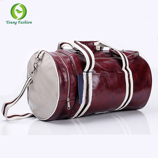 Young fashion British style men travel bags men messenger bags leather sports leisure shoulder bag cylindrical package(China (Mainland))