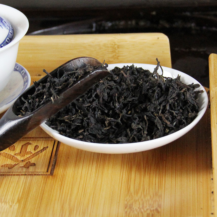 Wholesale Anhua dark tunnel Lianxilechu day level six holes 1000g Zhumie tip mounted pine scent(China (Mainland))