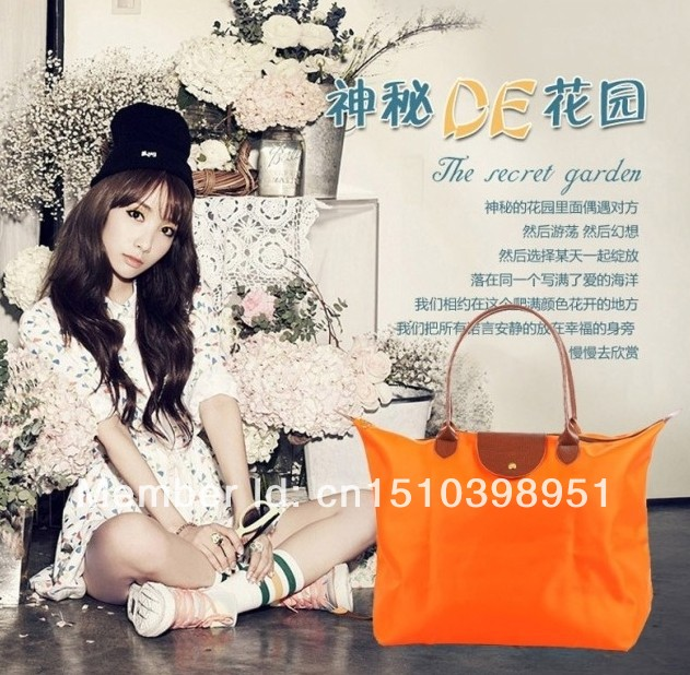 fashion shopping bags,can flod to make another small bags,many color,suit for all seasons,fashion and casual,shot handle,(China (Mainland))