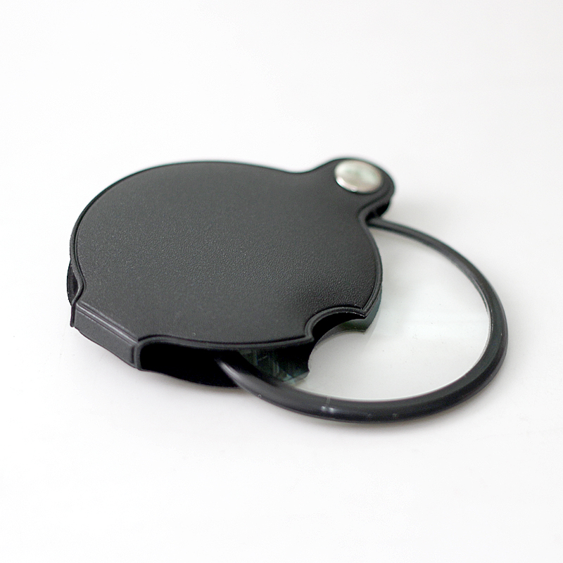 Фотография 10 times the best folding magnifier 60mm portable leather box pocket magnifier Claus reading newspaper