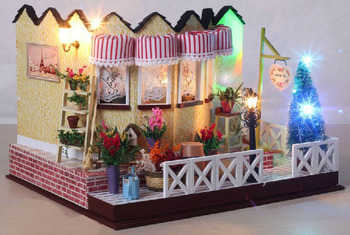 The large DIY Christmas dollhouse creative handmade model milk tea shop with glass dust cover + the colorful lights + music+doll