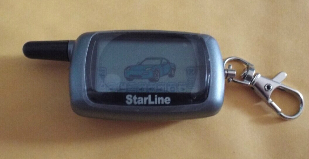 FREE shipping!!!2015 new STARLINR A6 LCD Remote controller two way car alarm system(China (Mainland))