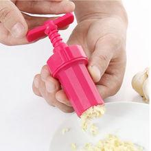 1 pc  New Design Garlic Press Easy to Use Garlic Press Stirrer Presser Peeler Crusher Home Kitchen Fruit Vegetable Tools(China (Mainland))