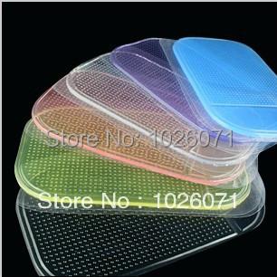 50pcs/lot Car Magic Grip Sticky Pad Anti Slide Dash Cell Phone Holder Non Slip Mat Clear(China (Mainland))