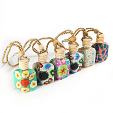 100pcs lot roll on print perfume bottles polymer clay empty small perfume refillable bottle Car Pendant