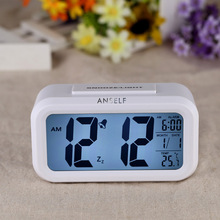 Anself LED Digital Clock Repeating Snooze Alarm Clock Light-activated Sensor Table Clock Backlight Time Date Temperature Display(China (Mainland))