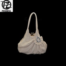 woman bag 2016 material is a high quality faux leather zipper is nylon