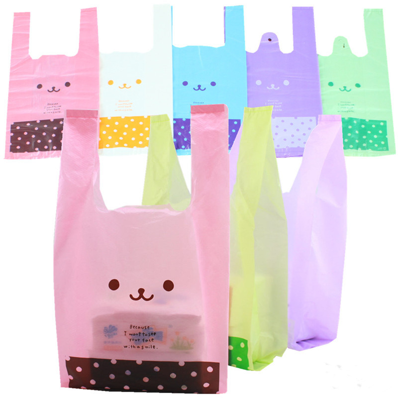 Free shipment Size 18*35cm three color supermarket shopping bag vest bag plastic bags with handle snack boutique clothing bag(China (Mainland))