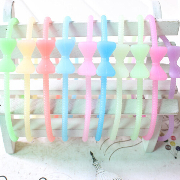 30pcs /lot 2015 New Arrival High Elastic Silicon Bow Knot Hair Bands For Women Elastic Hair Bands In Women's Hair Accessories(China (Mainland))