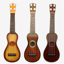 [PCMOS] Pear Shapes Kids Classic Mini Educational Ukulele Guitar String Type Music Toy Doll No Box T1079(China (Mainland))