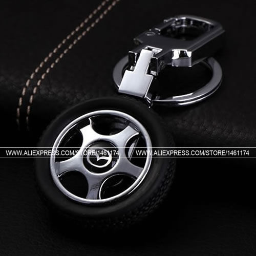 (1pcs)Free Shipping Hub Rotating Tires Mazda Keychain Key Ring Key Chain Men and Women Christmas(China (Mainland))