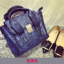 2015 European American swing wings leather handbags messenger bags diagonal small satchel simple bat smiley little monster
