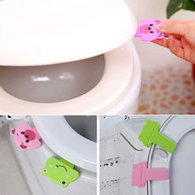 Azeroin Hot Sale Creative cute cartoon portable toilets lid handle Uncovery flip lid Toilet cover lifter Free Shipping(China (Mainland))