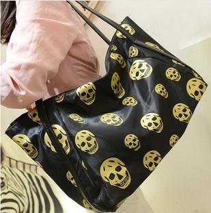 Large capacity skull personalized fashion casual handbags bronzing(China (Mainland))
