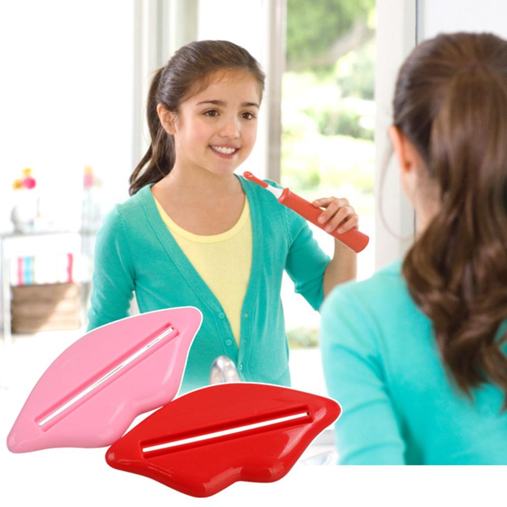 2 Pcs 2016 Hot Sexy Lip Kiss Bathroom Tube Dispenser Toothpaste Cream Squeezer Easy-using Home Bathroom Accessories HG0087(China (Mainland))