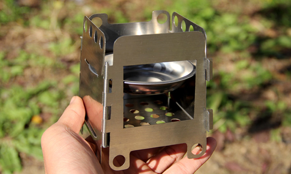 Pocket Lightweight Stainless Steel Folding Wood Stove Outdoor Camping Alcohol Stove Cooking Multi Fuel Stove Burner 9*8*11cm(China (Mainland))