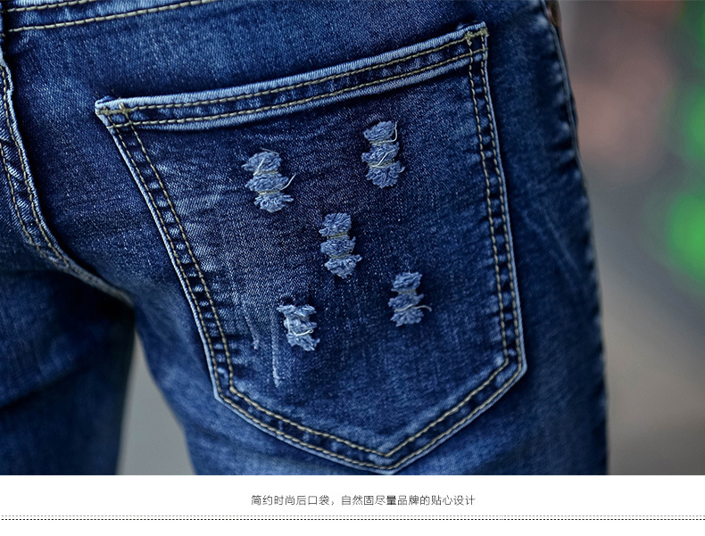 The new trend of men's jeans hole jeans stretch slim denim trousers